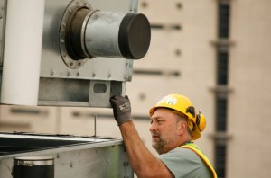 man working on hvac installation